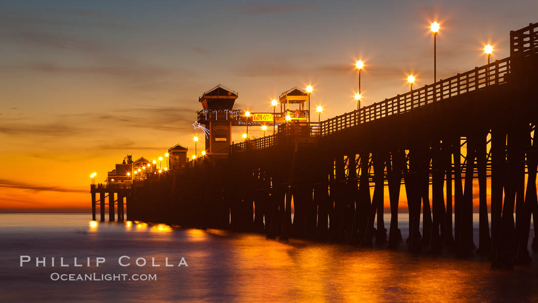Oceanside Pier at sunset, clouds with a brilliant sky at dusk, the lights on the pier are lit. California, USA, natural history stock photograph, photo id 27618