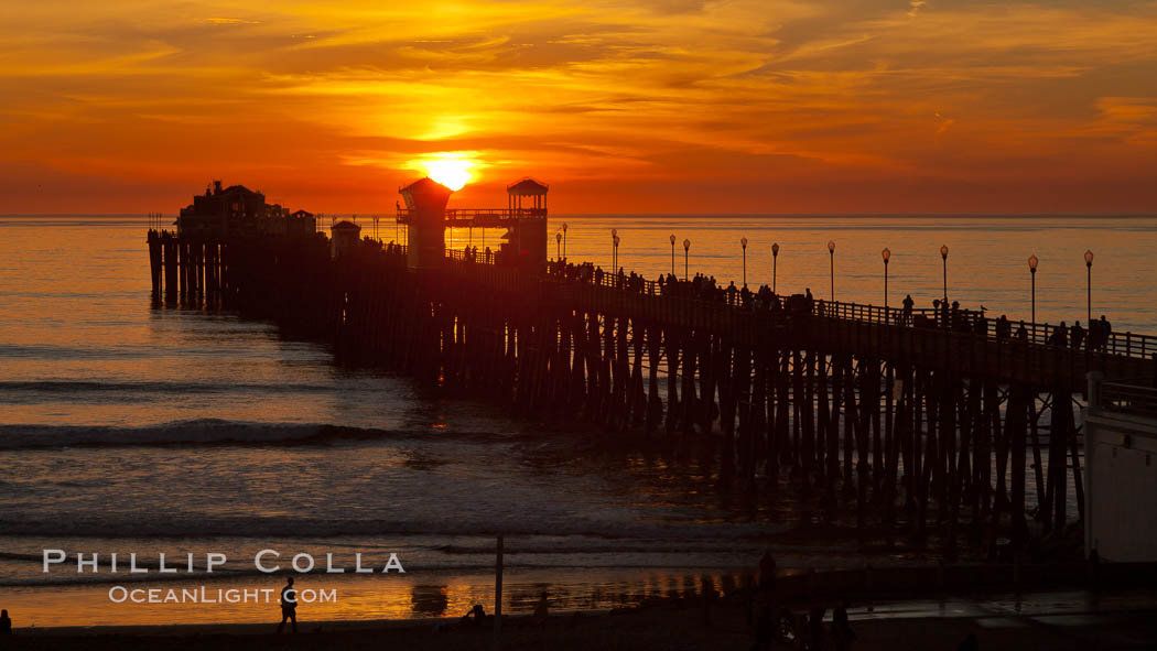 Oceanside Pier at sunset, clouds and palm trees with a brilliant sky at dusk. Oceanside Pier, Oceanside, California, USA, natural history stock photograph, photo id 27608
