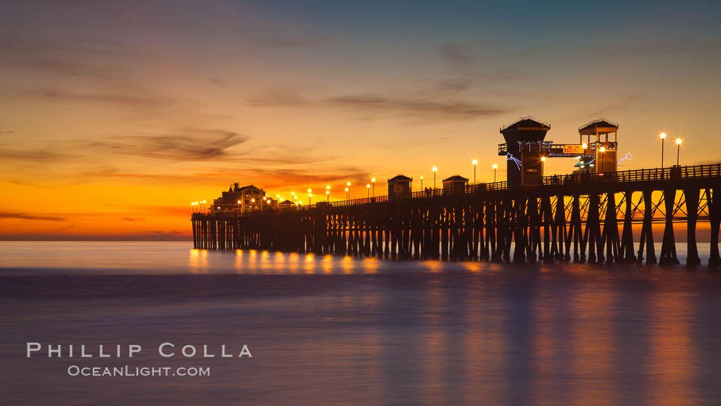 Oceanside Pier at sunset, clouds with a brilliant sky at dusk, the lights on the pier are lit. Oceanside Pier, Oceanside, California, USA, natural history stock photograph, photo id 27617