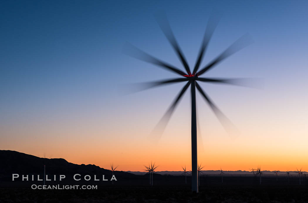 Express Wind Energy Projects, moving turbines lit by the rising sun,