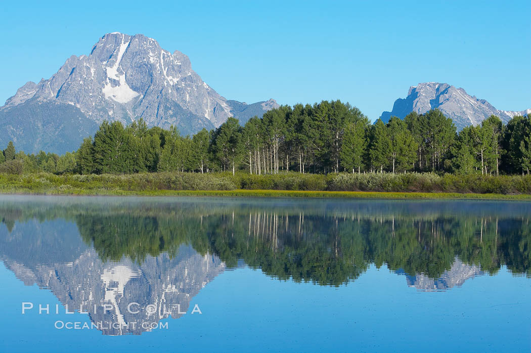 Mount Moran rises above the Snake River at Oxbow Bend.,  Copyright Phillip Colla, image #13027, all rights reserved worldwide.