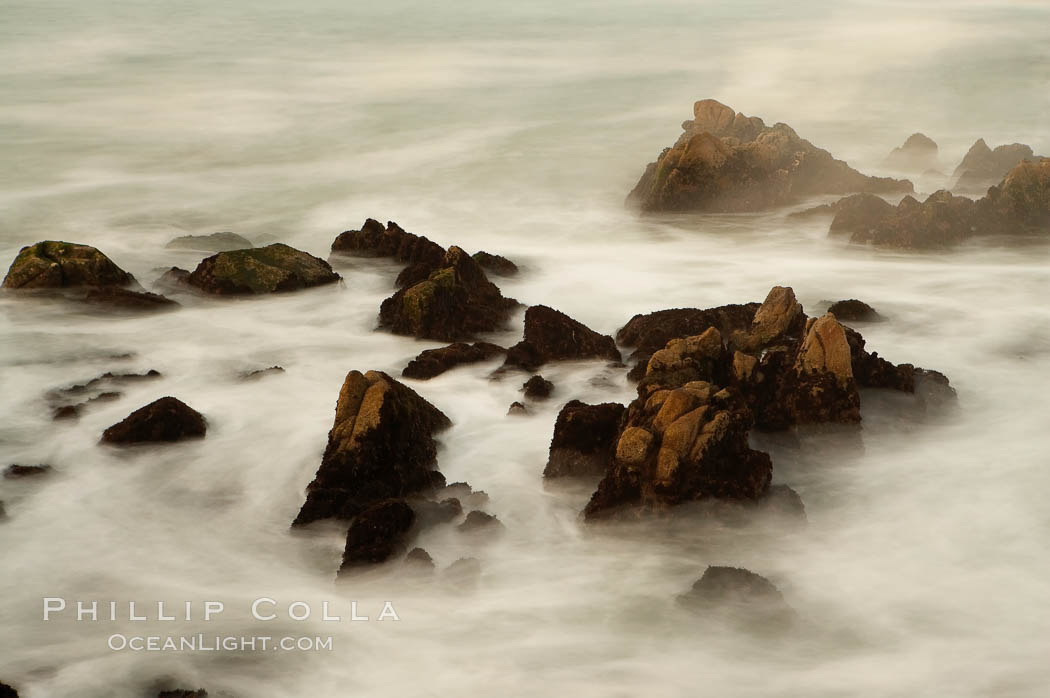 Waves breaking over rocks appear as a foggy mist in this time exposure.  Pacific Grove.,  Copyright Phillip Colla, image #14908, all rights reserved worldwide.