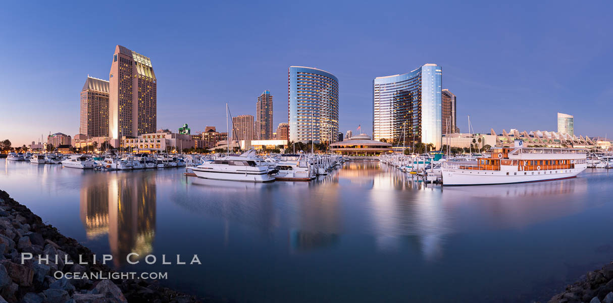 Panoramic photo of San Diego embarcadero, showing the San Diego Marriott Hotel and Marina (center), Roy&#39;s Restaurant (center) and Manchester Grand Hyatt Hotel (left) viewed from the San Diego Embarcadero Marine Park