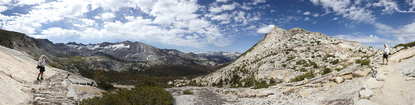 Panoramic view from Vogelsang Pass (10685')  in Yosemite's high country, looking south. A hiker appears twice in this curious panoramic photo, enjoying the spectacular view.  Visible on the left are Parson's Peak (12147'), Gallison Lake and Bernice Lake, while Vogelsang Peak (11516') rises to the right. Yosemite National Park, California, USA, natural history stock photograph, photo id 23210