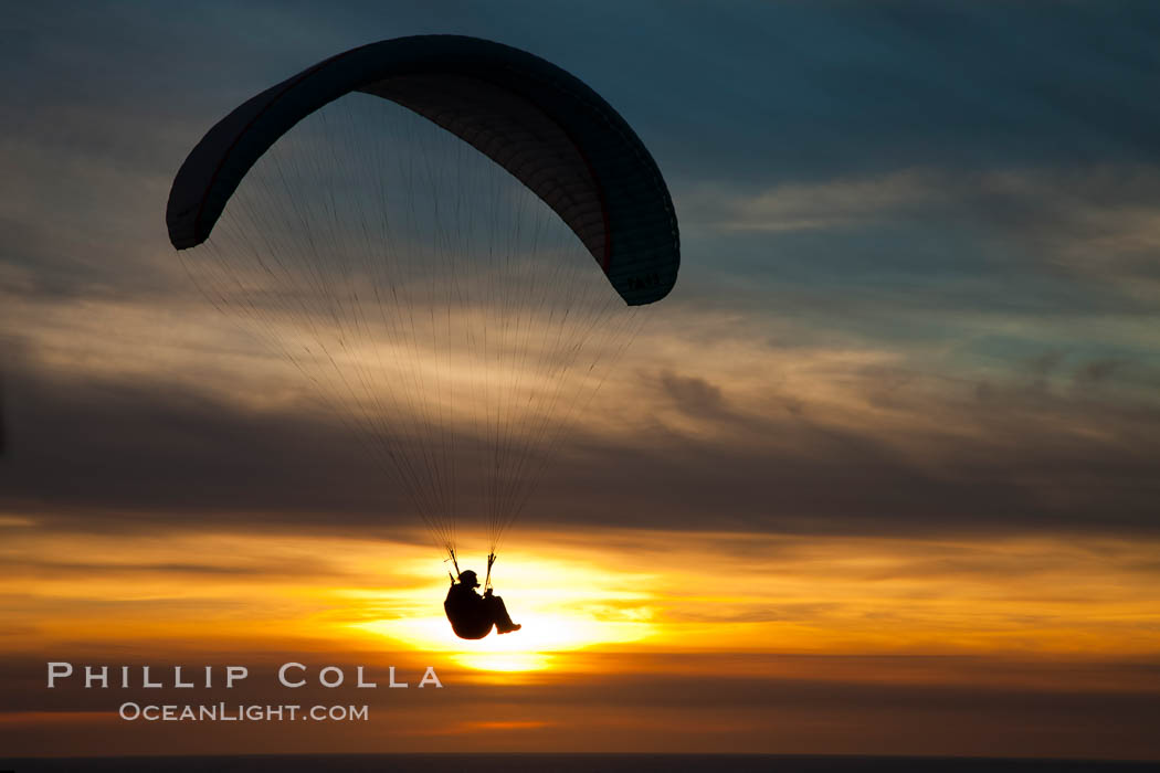 Paraglider soaring at Torrey Pines Gliderport, sunset, flying over the Pacific Ocean. La Jolla, California, USA, natural history stock photograph, photo id 24286