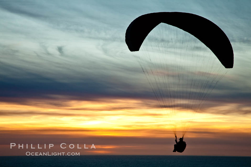 Paraglider soaring at Torrey Pines Gliderport, sunset, flying over the Pacific Ocean. La Jolla, California, USA, natural history stock photograph, photo id 24298