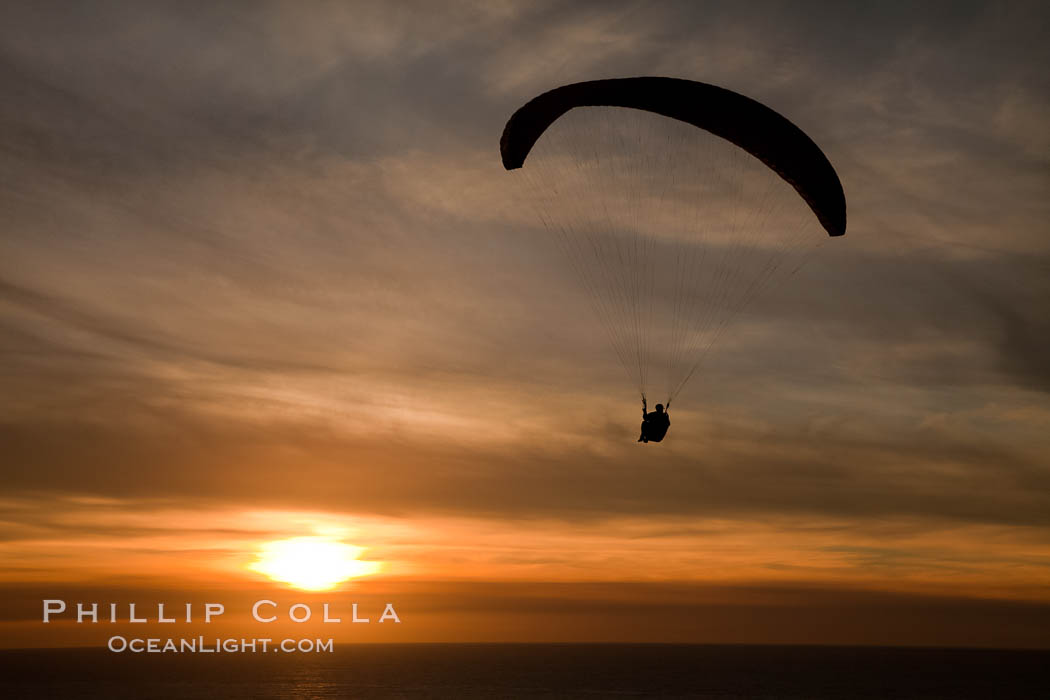 Paraglider soaring at Torrey Pines Gliderport, sunset, flying over the Pacific Ocean. La Jolla, California, USA, natural history stock photograph, photo id 24296