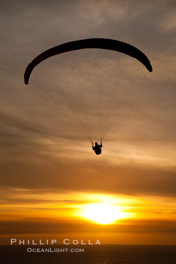 Paraglider soaring at Torrey Pines Gliderport, sunset, flying over the Pacific Ocean. La Jolla, California, USA, natural history stock photograph, photo id 24287