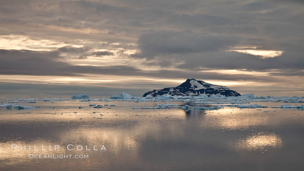 Paulet Island, near the Antarctic Peninsula, is a cinder cone flanks by lava flows on which thousands of Adelie Penguins nest. Paulet Island, Antarctic Peninsula, Antarctica, natural history stock photograph, photo id 24824