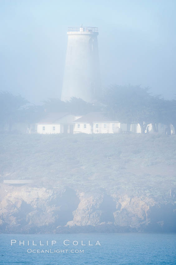 Piedras Blancas lighthouse.  Completed in 1875, the 115-foot-tall Piedras Blancas lighthouse is one of the few tall-style lighthouses on the West Coast of the United States.  Piedras Blancas, named for a group of three white rocks just offshore, is north of San Simeon, California very close to Hearst Castle.,  Copyright Phillip Colla, image #20348, all rights reserved worldwide.