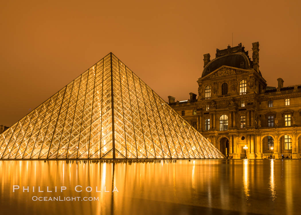 The Louvre Pyramid at Night, Pyramide du Louvre,  large glass and metal pyramid in the main courtyard (Cour Napoleon) of the Louvre Palace (Palais du Louvre) in Paris, Musee du Louvre