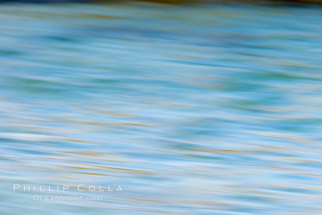 Abstract colors and water patterns on the ocean surface.,  Copyright Phillip Colla, image #20343, all rights reserved worldwide.