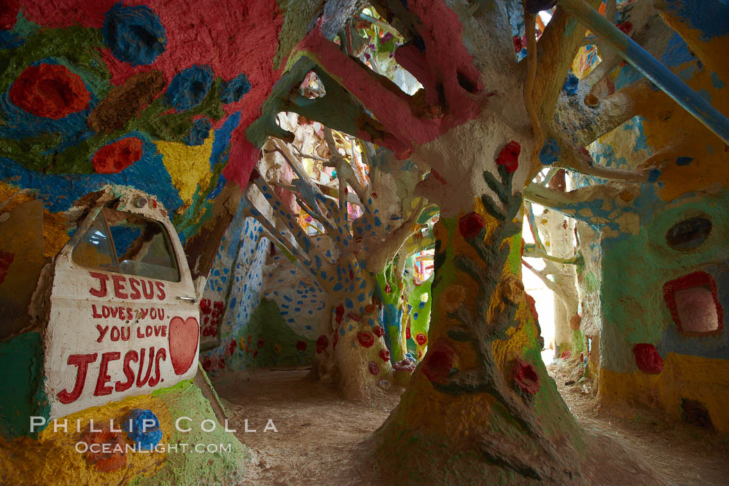 Salvation Mountain, near the desert community of Slab City and the small town of Niland on the east side of the Salton Sea.  Built over several decades by full-time resident Leonard Knight, who lives at the site, Salvation Mountain was built from over 100,000 gallons of paint, haybales, wood and metal and was created by Mr. Knight to convey the message that God Loves Everyone.,  Copyright Phillip Colla, image #22506, all rights reserved worldwide.