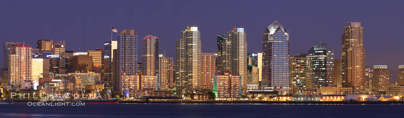 San Diego city skyline at sunset, showing the buildings of downtown San Diego rising above San Diego Harbor, viewed from Harbor Island.  A panoramic photograph, composite of thirteen separate images