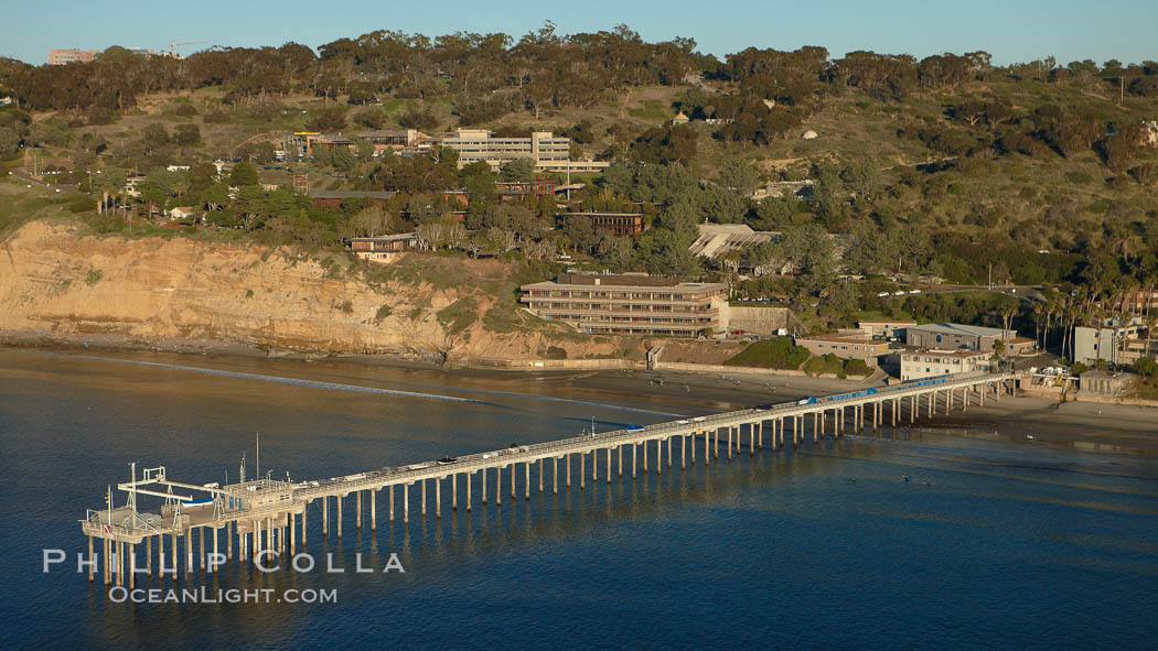 SIO Pier.  The Scripps Institution of Oceanography research pier is 1090 feet long and was built of reinforced concrete in 1988, replacing the original wooden pier built in 1915. The Scripps Pier is home to a variety of sensing equipment above and below water that collects various oceanographic data. The Scripps research diving facility is located at the foot of the pier. Fresh seawater is pumped from the pier to the many tanks and facilities of SIO, including the Birch Aquarium. The Scripps Pier is named in honor of Ellen Browning Scripps, the most significant donor and benefactor of the Institution.,  Copyright Phillip Colla, image #22293, all rights reserved worldwide.