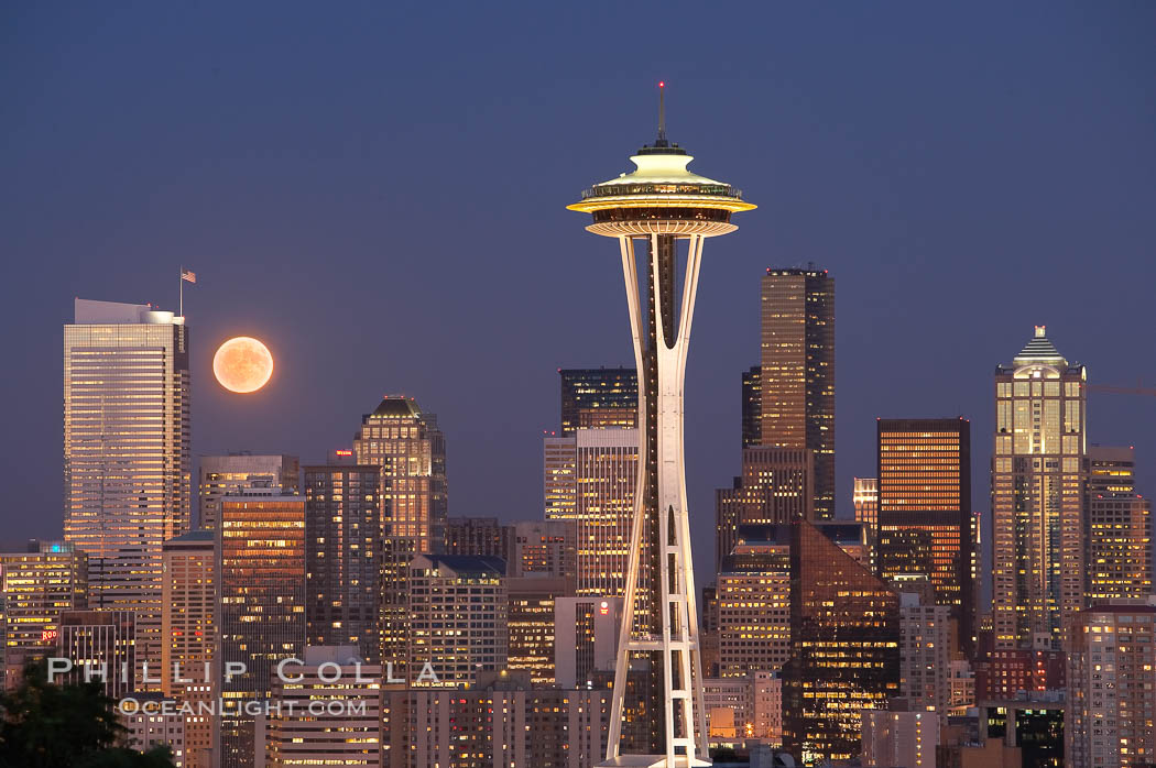 Full moon rises over Seattle city skyline at dusk, Space Needle at right.,  Copyright Phillip Colla, image #13661, all rights reserved worldwide.