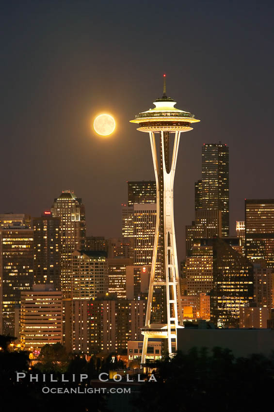 Full moon rises over Seattle city skyline, Space Needle at right.,  Copyright Phillip Colla, image #13665, all rights reserved worldwide.