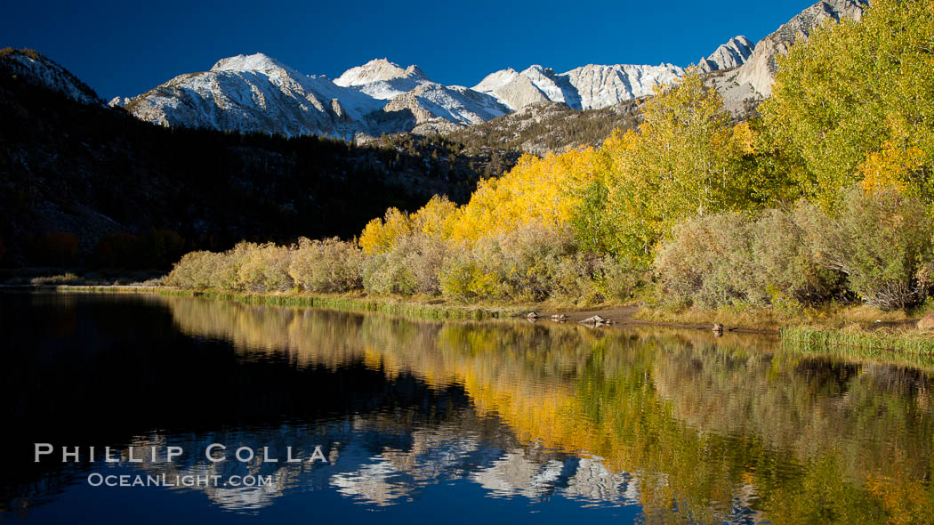 Sierra Nevada mountains and aspen trees, fall colors reflected in the still waters of North Lake. Bishop Creek Canyon Sierra Nevada Mountains, Bishop, California, USA, Populus tremuloides, natural history stock photograph, photo id 26061