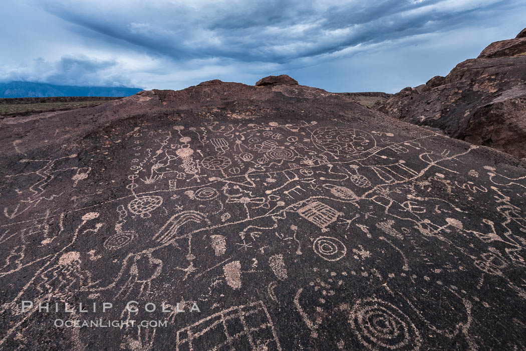 Sky Rock petroglyphs near Bishop, California.  Hidden atop an enormous boulder in the Volcanic Tablelands lies Sky Rock, a set of petroglyphs that face the sky.  These superb examples of native American petroglyph artwork are thought to be Paiute in origin, but little is known about them. Bishop, California, USA, natural history stock photograph, photo id 27000