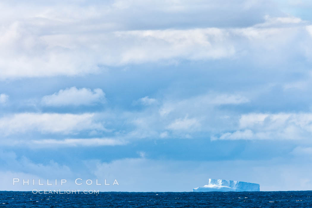 Clouds, weather and light mix in neverending forms over the open ocean of Scotia Sea, in the Southern Ocean