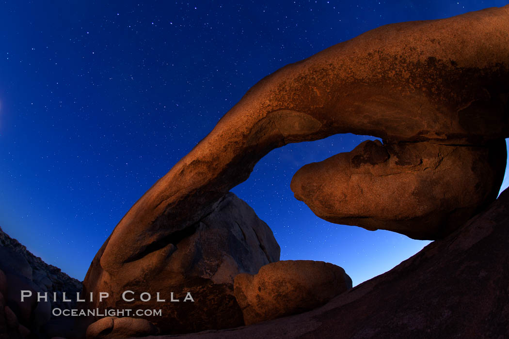 Star trails and Arch Rock. Polaris, the North Star, is at the center of the circular arc star trails as they pass above this natural stone archway in Joshua Tree National Park. Alabama Hills Recreational Area, California, USA, natural history stock photograph, photo id 27707