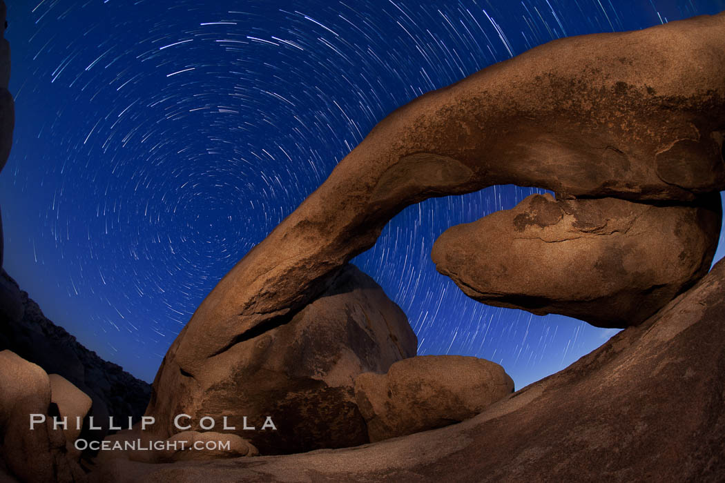 Star trails and Arch Rock. Polaris, the North Star, is at the center of the circular arc star trails as they pass above this natural stone archway in Joshua Tree National Park. Alabama Hills Recreational Area, California, USA, natural history stock photograph, photo id 27709