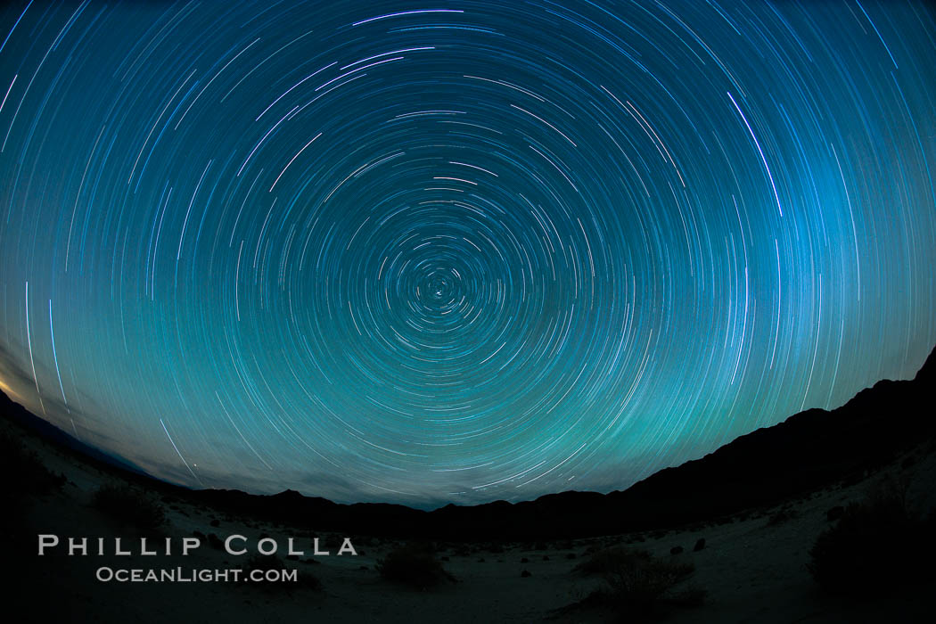 Star trails, rotating around the North Star (Polaris), seen from Death Valley. Milky Way Galaxy, The Universe, natural history stock photograph, photo id 25270