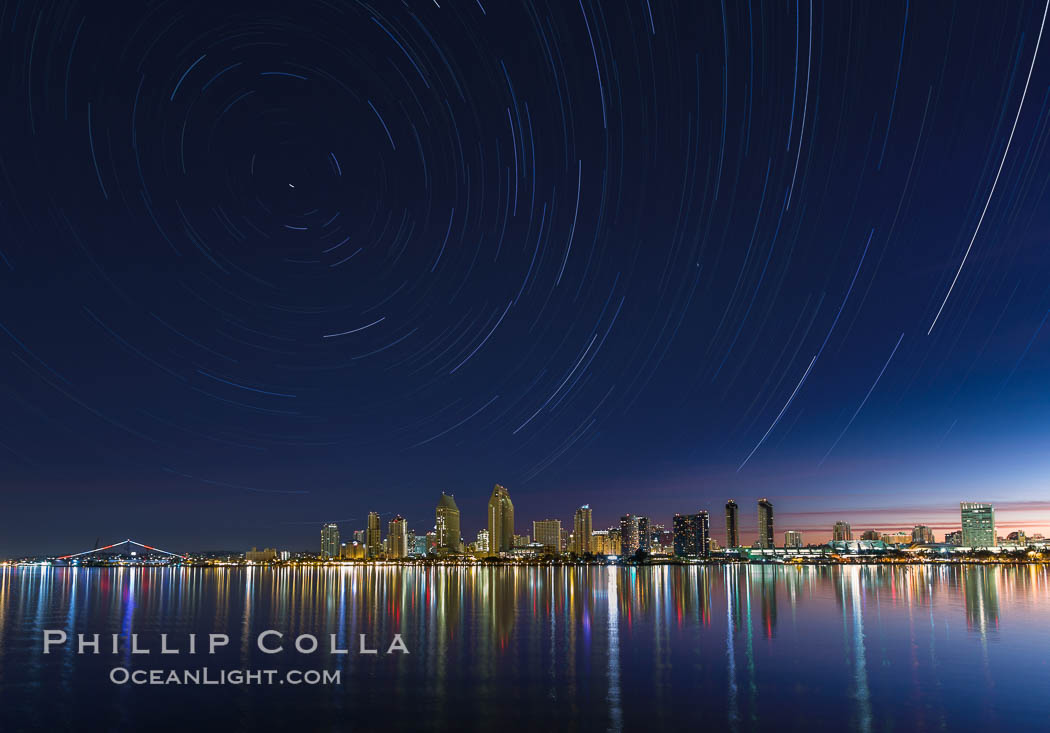 Approaching sunrise and star trails over the San Diego Downtown City Skyline.  In this 60 minute exposure, stars create trails through the night sky over downtown San Diego. California, USA, natural history stock photograph, photo id 28387