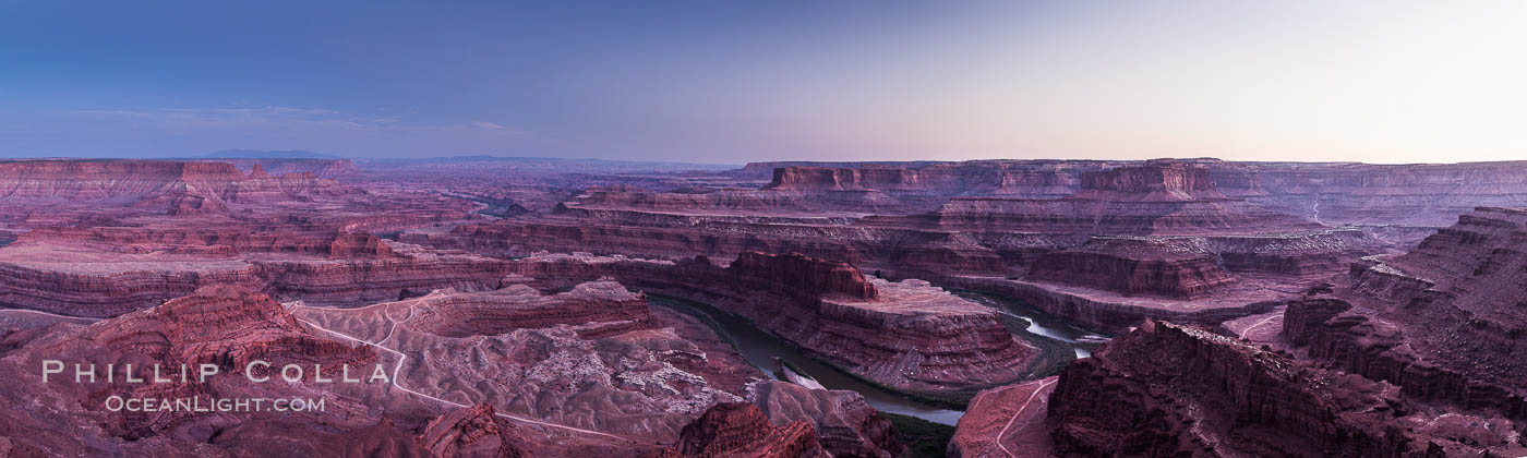 Sunset at Dead Horse Point Overlook, with the Colorado River flowing 2,000 feet below. 300 million years of erosion has carved the expansive canyons, cliffs and walls below and surrounding Deadhorse Point, Dead Horse Point State Park, Utah