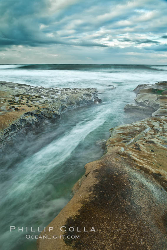 Waves wash over sandstone reef, clouds and sky. La Jolla, California, USA, natural history stock photograph, photo id 26341