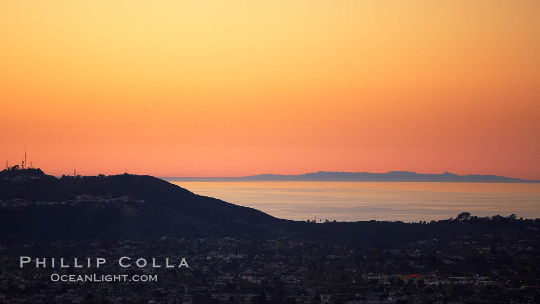Mount Soledad juxtaposed against a distant San Clemente Island at sunset.,  Copyright Phillip Colla, image #22316, all rights reserved worldwide.