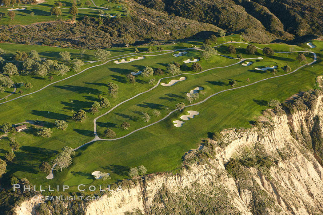 Torrey Pines Golf Course, south course holes 2, 4 and 5.  Torrey Pines golf course, situated atop the magnificent 300 foot tall seacliffs, offers majestic views of the Pacific Ocean south to La Jolla.  Scattered around the course are found Torrey pine trees, one of the rare species of pines in the world, San Diego, California