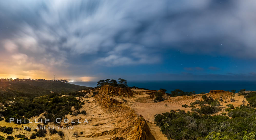 Torrey Pines State Reserve at Night, stars and clouds fill the night sky with the lights of La Jolla visible in the distance. Torrey Pines State Reserve, San Diego, California, USA, natural history stock photograph, photo id 28405
