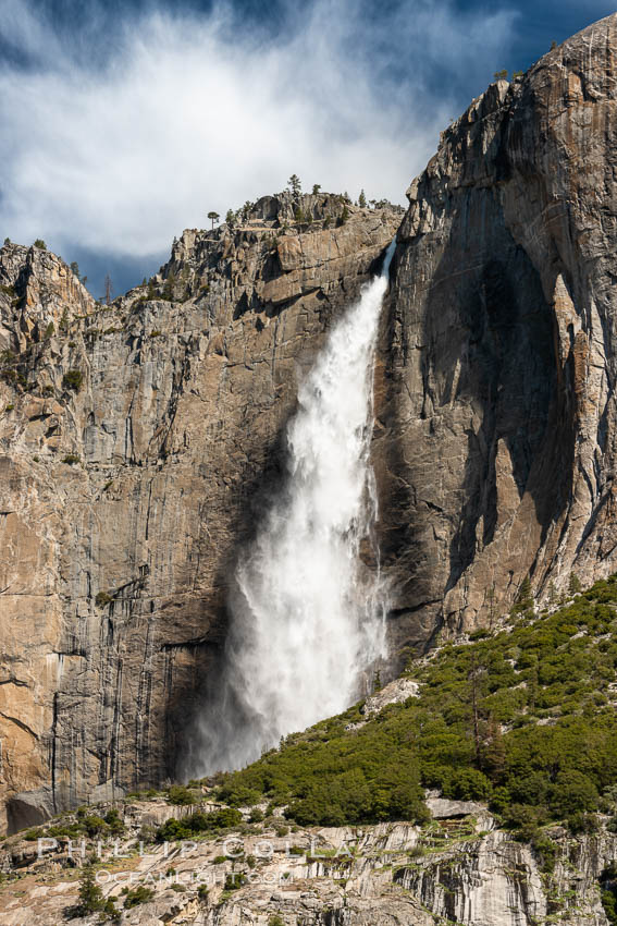 Upper Yosemite Falls near peak flow in spring. Yosemite Falls, at 2425 feet tall (730m) is the tallest waterfall in North America and fifth tallest in the world, Yosemite National Park, California