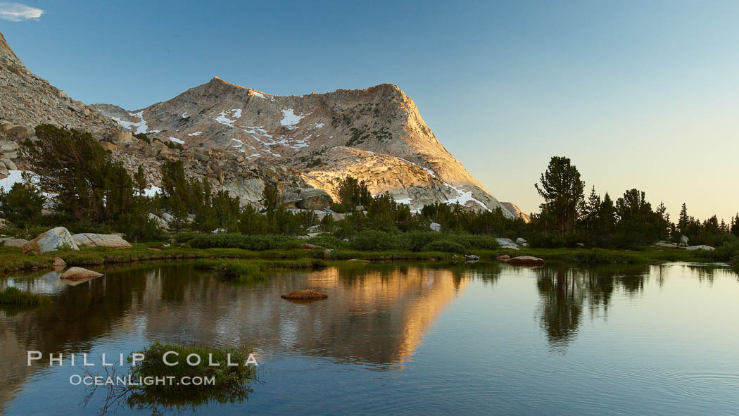 Vogelsang Peak (11516') at sunset, reflected in a small creek near Vogelsang High Sierra Camp in Yosemite's high country, Yosemite National Park, California