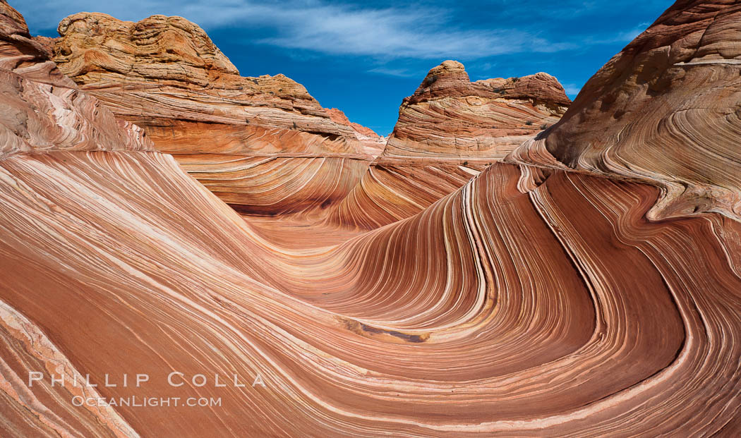 The Wave, an area of fantastic eroded sandstone featuring beautiful swirls, wild colors, countless striations, and bizarre shapes set amidst the dramatic surrounding North Coyote Buttes of Arizona and Utah.  The sandstone formations of the North Coyote Buttes, including the Wave, date from the Jurassic period. Managed by the Bureau of Land Management, the Wave is located in the Paria Canyon-Vermilion Cliffs Wilderness and is accessible on foot by permit only.,  Copyright Phillip Colla, image #20625, all rights reserved worldwide.