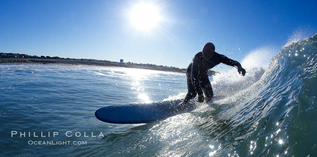 Longboarder carves wave in early morning sun.,  Copyright Phillip Colla, image #21783, all rights reserved worldwide.