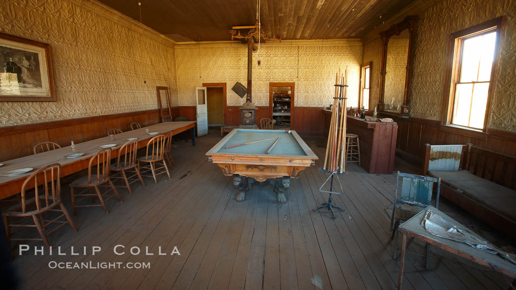 Wheaton and Hollis Hotel, interior of pool room and parlor, Bodie State Historical Park, California, Keywords: bodie, bodie ghost town, bodie state historic park, bodie state historical park, california, ghost town, mining town, state parks, usa, arrested decay, gold mining, gold rush, historic state park, sierra, state park, west, bridgeport, gold mine, mining camp, outdoors, outside, town, village, old west, guest house, hotel, inn, lodge, lodging, eastern sierra,  Copyright Phillip Colla, image #23110, all rights reserved worldwide.