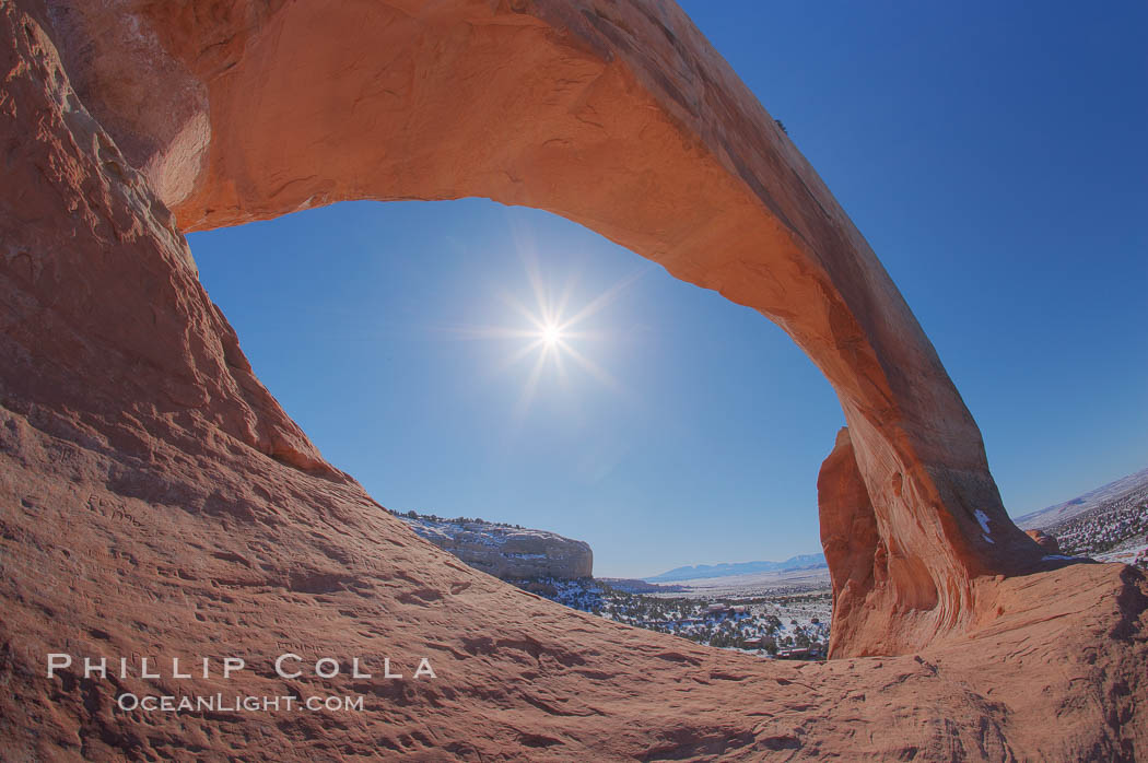 Wilson Arch rises high above route 191 in eastern Utah, with a span of 91 feet and a height of 46 feet.,  Copyright Phillip Colla, image #18031, all rights reserved worldwide.