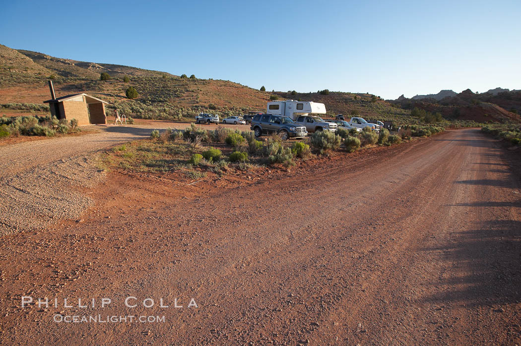 Wire Pass trailhead.  The parking lot at the Wire Pass trailhead, early morning, as hikers arrive and set out to Buckskin Gulch, the North Coyote Buttes and the Wave.,  Copyright Phillip Colla, image #20745, all rights reserved worldwide.