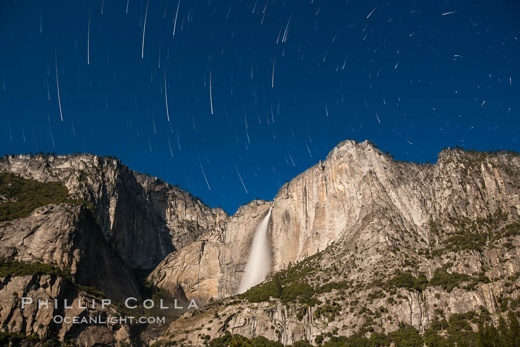 Yosemite Falls and star trails, at night, viewed from Cook's Meadow, illuminated by the light of the full moon. Yosemite Falls, Yosemite National Park, California, USA, natural history stock photograph, photo id 27734