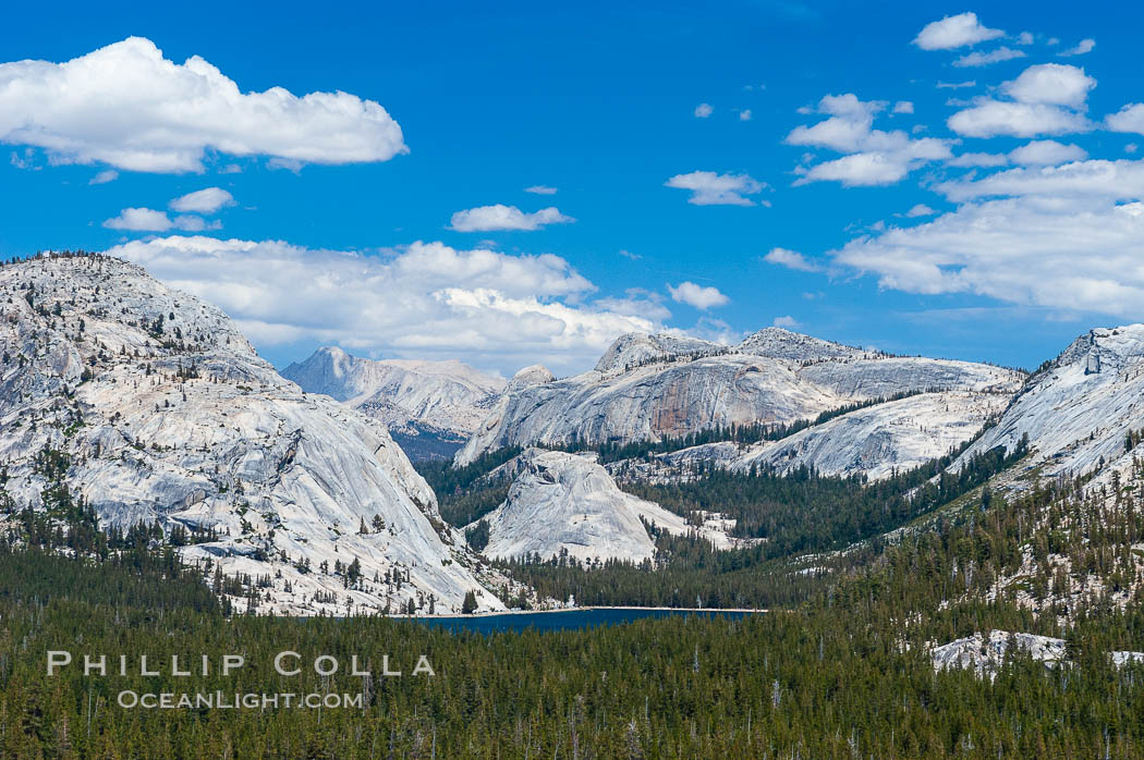 Tenaya Lake is surrounded by epic granite domes.  Late afternoon, viewed from Olmstead Point.,  Copyright Phillip Colla, image #09955, all rights reserved worldwide.