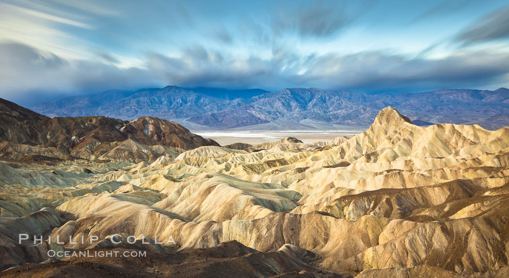 Zabriskie Point sunrise, clouds blurred by long time exposure, Death Valley National Park, California. Zabriskie Point, Death Valley National Park, California, USA, natural history stock photograph, photo id 27655