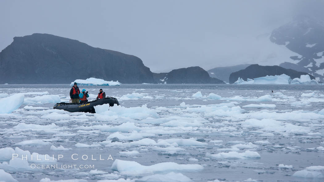 Zodiac cruising in Antarctica.  Motoring in an inflatable zodiac through pack ice along the Antarctic Peninsula. Cierva Cove, Antarctic Peninsula, Antarctica, natural history stock photograph, photo id 25563