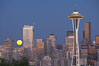 Full moon rises over Seattle city skyline at dusk, Space Needle at right. Washington, USA. Image #13660