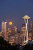 Full moon rises over Seattle city skyline, Space Needle at right. Washington, USA. Image #13664