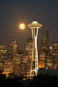 Full moon rises over Seattle city skyline, Space Needle at right. Washington, USA. Image #13665