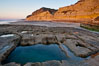 Sandstone cliffs of Torrey Pines State Reserve rise above a tidepool.  San Diego. California, USA. Image #14746