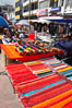 Otavalo market, a large and famous Andean market high in the Ecuadorian mountains, is crowded with locals and tourists each Saturday. San Pablo del Lago. Image #16798