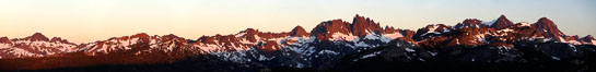 Panorama of the Minarets at sunrise, near Mammoth Mountain.  The Minarets are a series of seventeen jagged peaks in the Ritter Range, west of Mammoth Mountain in the Ansel Adams Wilderness.  These basalt peaks were carved by glaciers on both sides of the range.  The highest of the Minarets stands 12,281 feet above sea level. Mammoth Lakes, California, USA. Image #19123